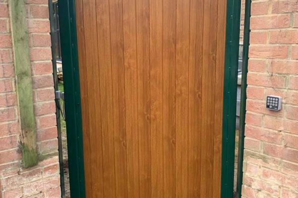 00001automated pedestrian gate golden oak PVC