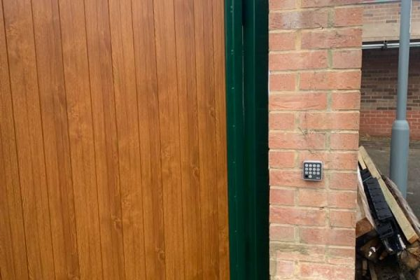 00003automated pedestrian gate golden oak PVC